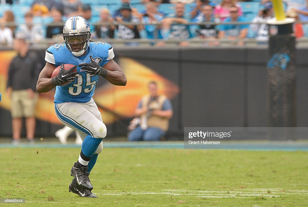 Mike Tolbert #35 of the Carolina Panthers runs against the Carolina Panthers during their game at Bank of America Stadium on September 14, 2014 in Charlotte, North Carolina. The Panthers won 24-7.