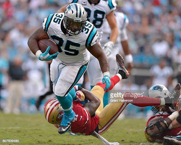 Mike Tolbert of the Carolina Panthers runs over Antoine Bethea of the San Francisco 49ers during the game at Bank of America Stadium on September 18...