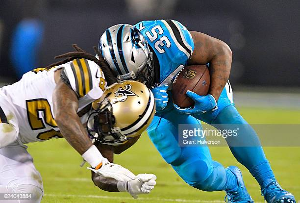 Mike Tolbert of the Carolina Panthers runs the ball against BW Webb of the New Orleans Saints in the third quarter during the game at Bank of America...