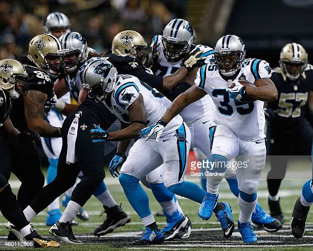 Mike Tolbert of the Carolina Panthers runs the ball away from the pack during the second quarter against the New Orleans Saints at MercedesBenz...