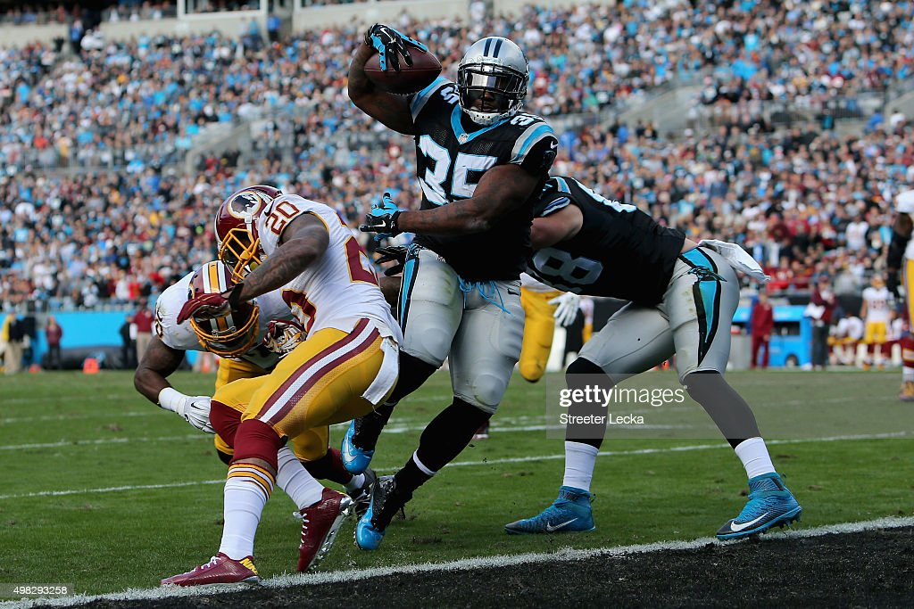 Mike Tolbert #35 of the Carolina Panthers scores a touchdown against Jeron Johnson #20 of the Washington Redskins in the 1st quarter during their game at Bank of America Stadium on November 22, 2015 in Charlotte, North Carolina.