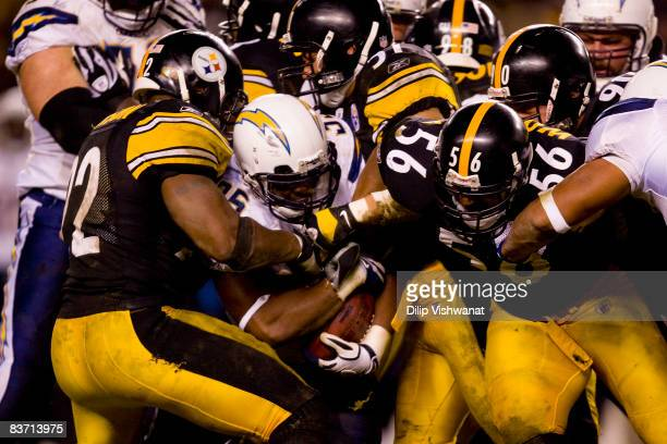 Mike Tolbert of the San Diego Chargers is gang tackled by the Pittsburgh Steelers defense at Heinz Field on November 16 2008 in Pittsburgh...