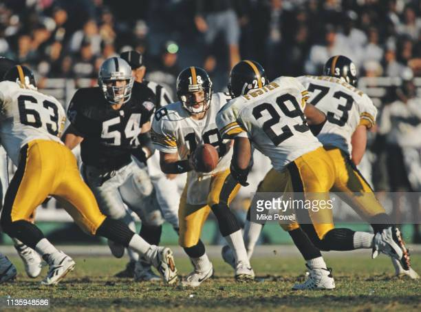Mike Tomczak, Quarterback for the Pittsburgh Steelers hands off to Running Back Barry Foster during the American Football Conference West game on...
