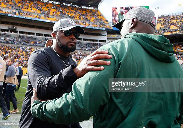 Mike Tomlin of the Pittsburgh Steelers and Todd Bowles of the New York Jets shake hands at mid field during the game on October 9 2016 at Heinz Field...