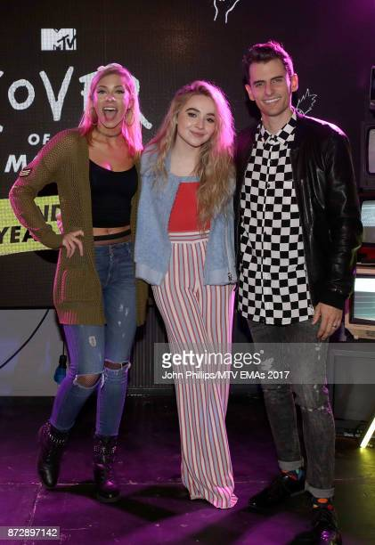 Mike Tompkins and Andie Case winners of the Cover of The Year Award pose with Sabrina Carpenter during the MTV EMAs 2017 Breaks Sessions on November...