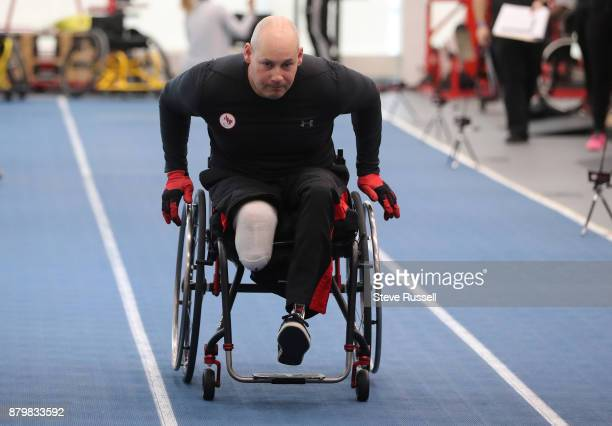 TORONTO OH NOVEMBER 26 Mike Trauner an Invictus Games double gold medalist in indoor rowing sprints 20 metres during the Paralympian Search a oneday...