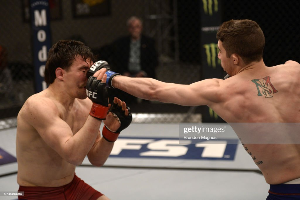 Mike Triziano punches John Gunther in their semi final fight during the filming of The Ultimate Fighter: Undefeated on February 27, 2017 in Las Vegas, Nevada.