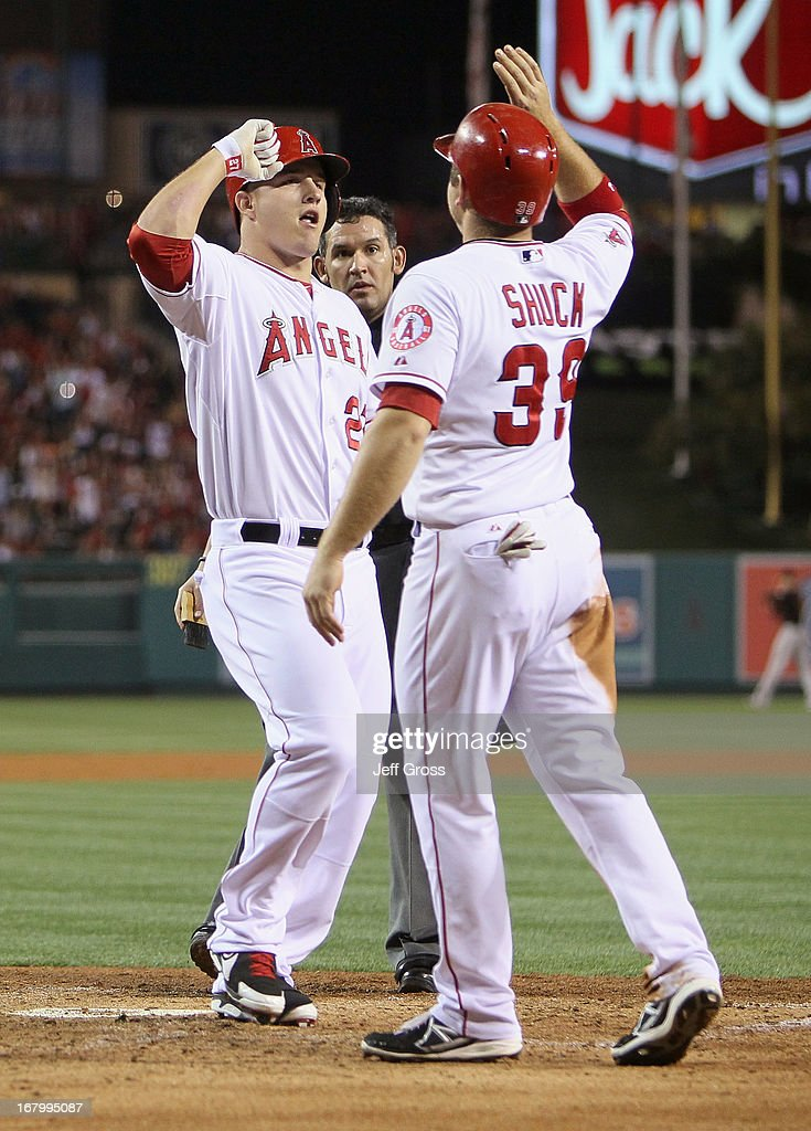 Mike Trout (L) #27 of the Los Angeles Angels of Anaheim is congratulated by J.B. Shuck #39 after hitting a two-run home run in the fifth inning against the Baltimore Orioles at Angel Stadium of Anaheim on May 3, 2013 in Anaheim, California. The Angels defeated the Orioles 4-0.