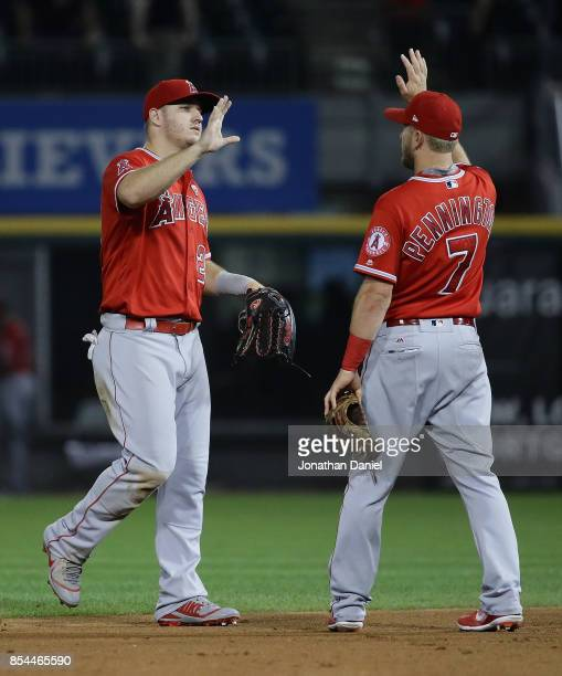 Mike Trout and Cliff Pennington of the Los Angeles Angels celebrate a win over the Chicago White Sox at Guaranteed Rate Field on September 26 2017 in...