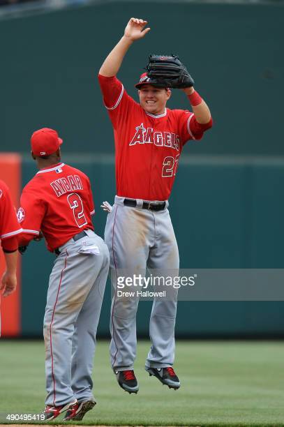 Mike Trout and Erick Aybar of the Los Angeles Angels celebrate a 30 win over the Philadelphia Phillies at Citizens Bank Park on May 14 2014 in...