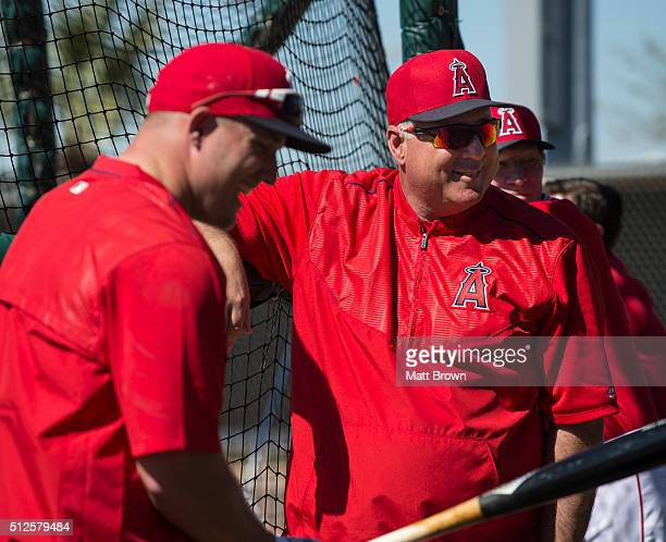 Mike Trout and manager Mike Scioscia of the Los Angeles Angels of Anaheim laugh during spring training on February 26 2016 at Tempe Diablo Stadium...