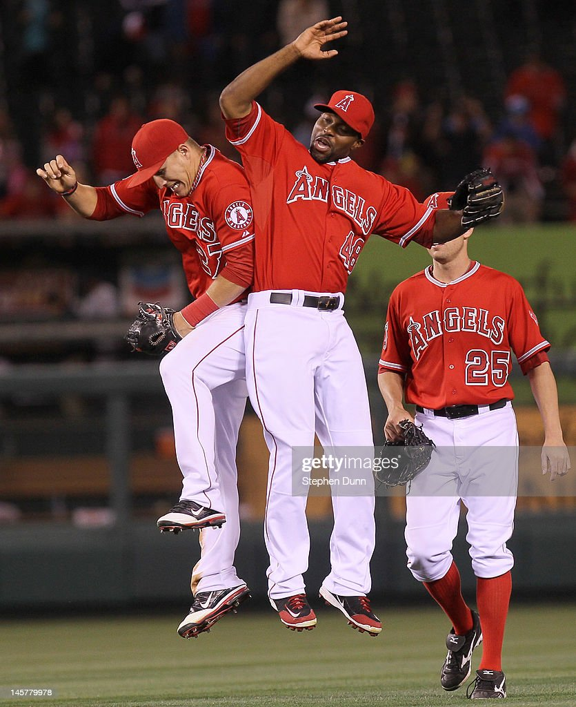 Mike Trout #27 and Torii Hunter #48 of the Los Angeles Angels of Anaheim jump to celebrate after the game with the Seattle Mariners at Angel Stadium of Anaheim on June 5, 2012 in Anaheim, California. The Angels won 6-1.