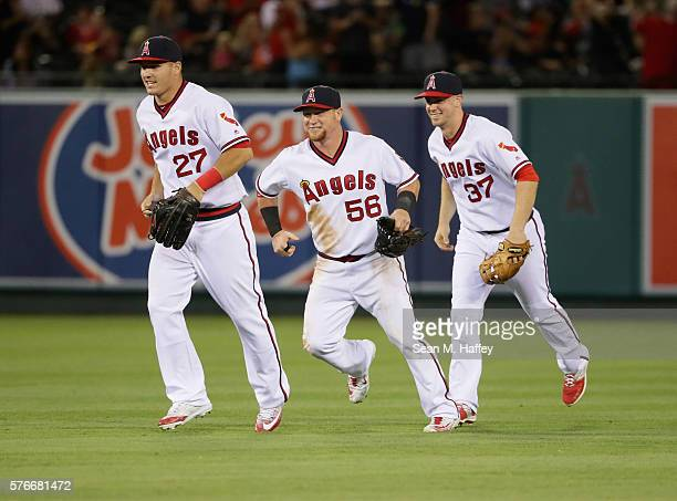 Mike Trout Kole Calhoun and Todd Cunningham of the Los Angeles Angels of Anaheim run off the field after defeating the Chicago White Sox 10 in a...