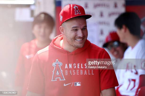 Mike Trout looks on from the dugout during the first inning against the Seattle Mariners at Angel Stadium of Anaheim on July 18, 2021 in Anaheim,...