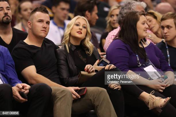 Mike Trout of the Los Angeles Angels and fiancee Jessica Cox attend the NBA game between the Phoenix Suns and the Oklahoma City Thunder at Talking...