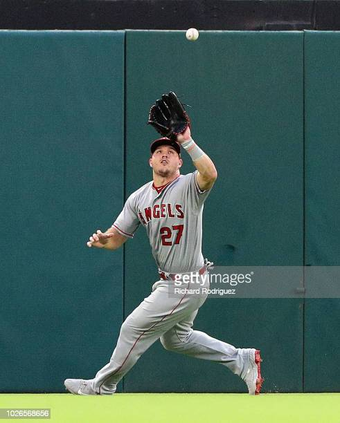 Mike Trout of the Los Angeles Angels catches a fly ball by Nomar Mazara of the Texas Rangers in the first inning of a baseball game at Globe Life...