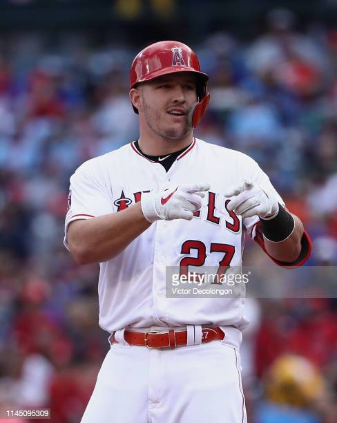 Mike Trout of the Los Angeles Angels gestures toward the Angels dugout after hitting a double in the first inning of the MLB game against the Kansas...