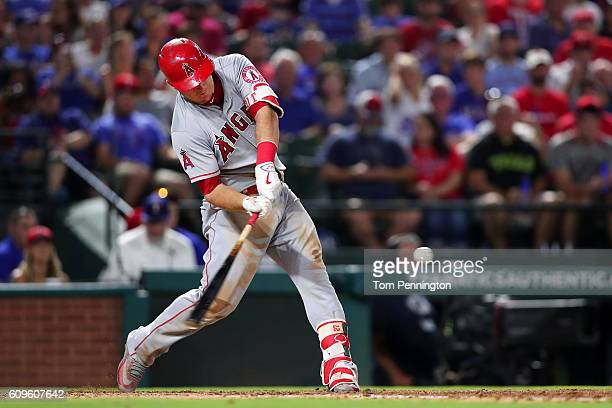 Mike Trout of the Los Angeles Angels hits a three run home run against the Texas Rangers in the top of the fifth inning at Globe Life Park in...