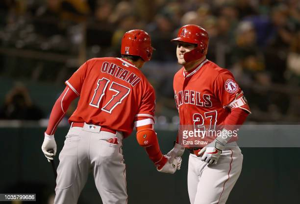 Mike Trout of the Los Angeles Angels is congratulated by Shohei Ohtani afte he hit a home run in the fourth inning against the Oakland Athletics at...