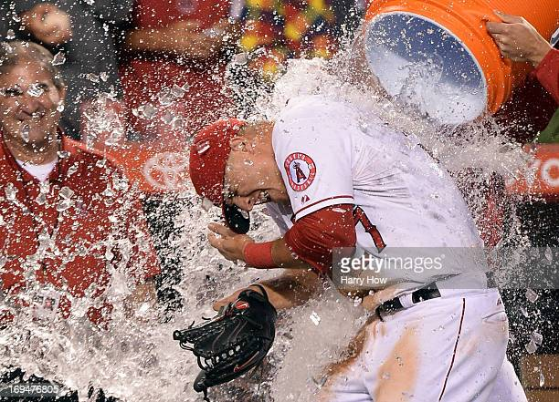 Mike Trout of the Los Angeles Angels is doused with water in celebration of hitting for the cycle after a 120 win over the Seattle Mariners at Angel...