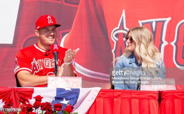 Mike Trout of the Los Angeles Angels left is joined by his wife Jessica at a press conference about his new contract outside Angel Stadium in Anaheim...