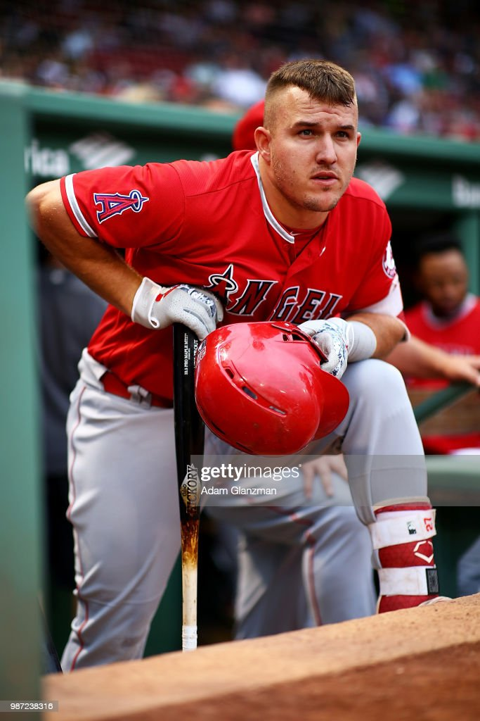 0d589a9ae Mike Trout of the Los Angeles Angels looks on from the dugout before ...