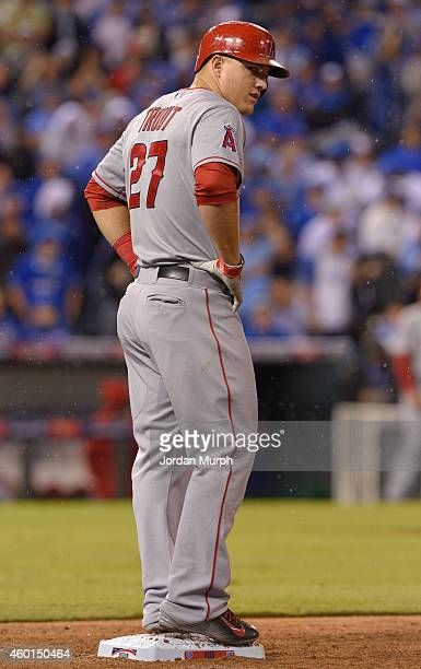 Mike Trout of the Los Angeles Angels looks through the rain during game 3 of the American League Division Series against the Kansas City Royals on...
