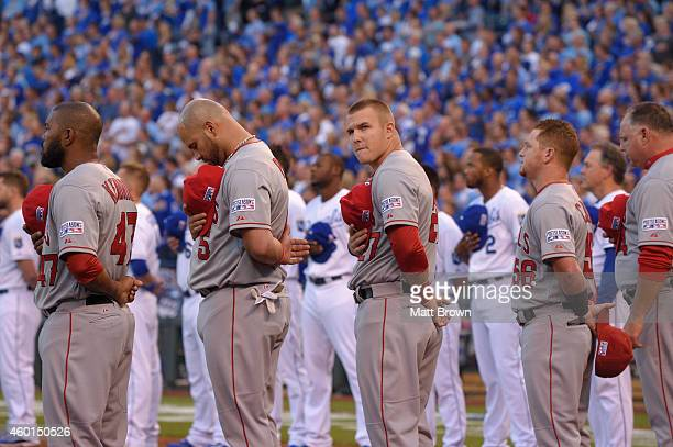 Mike Trout of the Los Angeles Angels looks towards the crowd during the National Anthem before game 3 of the American League Division Series against...