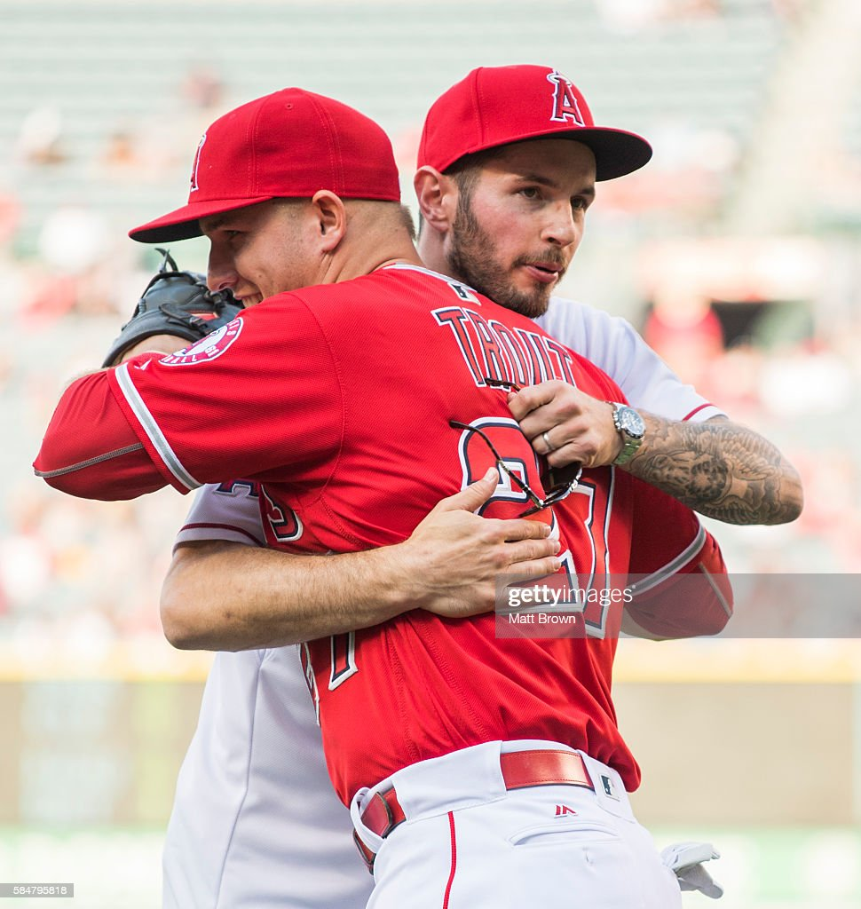 Mike Trout #27 of the Los Angeles Angels of Anaheim and Los Angeles Clippers basketball player J.J. Redick hug after Redick threw a ceremonial first pitch before the game between the Boston Red Sox and the Angels at Angel Stadium of Anaheim on July 30, 2016 in Anaheim, California.