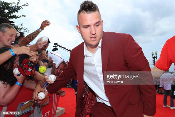 Mike Trout of the Los Angeles Angels of Anaheim and the American League signs autographs for fans at the 89th MLB AllStar Game presented by...