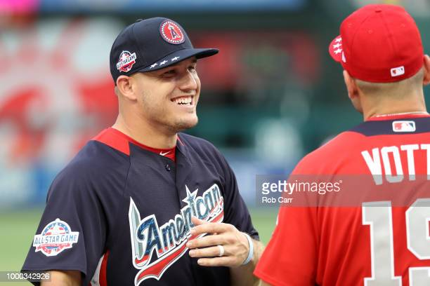 Mike Trout of the Los Angeles Angels of Anaheim and the American League speaks to Joey Votto of the Cincinnati Reds and the National League during...