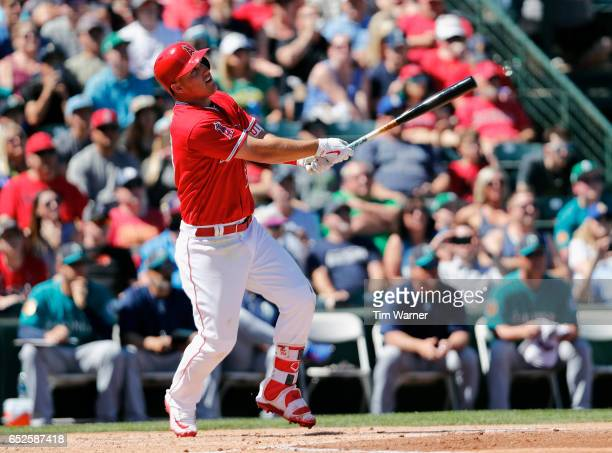 Mike Trout of the Los Angeles Angels of Anaheim bats in the first inning against the Seattle Mariners during a spring training game at Tempe Diablo...