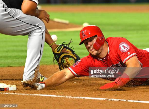 Mike Trout of the Los Angeles Angels of Anaheim beats the throw back to Jose Abreu of the Chicago White Sox as he is safe at first in the fifth...