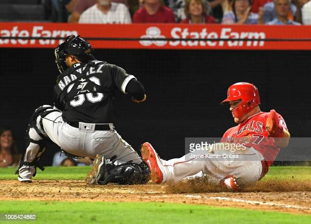 Mike Trout of the Los Angeles Angels of Anaheim beats the throw to Omar Narvaez of the Chicago White Sox for a run in the fifth inning at Angel...