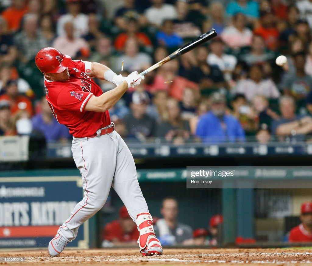 Mike Trout #27 of the Los Angeles Angels of Anaheim breaks his bat as he grounds into a double play in the ninth inning against the Houston Astros at Minute Maid Park on September 22, 2017 in Houston, Texas.