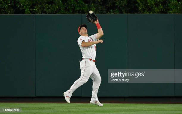 Mike Trout of the Los Angeles Angels of Anaheim catches a fly ball hit by Niko Goodrum of the Detroit Tigers in the fifth inning against the Los...
