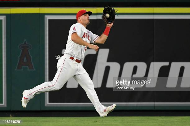 Mike Trout of the Los Angeles Angels of Anaheim catches a fly ball against the Detroit Tigers in the second inning at Angel Stadium of Anaheim on...
