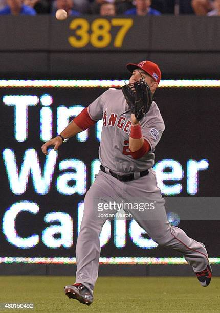 Mike Trout of the Los Angeles Angels of Anaheim catches the ball during game 3 of the American League Division Series against the Kansas City Royals...
