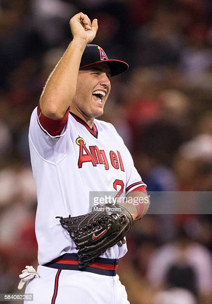 Mike Trout of the Los Angeles Angels of Anaheim celebrates after defeating the Chicago White Sox 70 during the game at Angel Stadium of Anaheim on...
