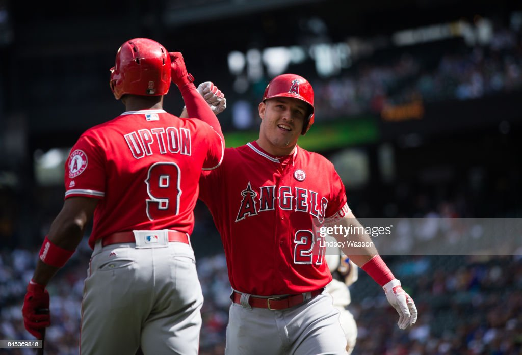 Mike Trout #27 of the Los Angeles Angels of Anaheim celebrates his solo home run in the first inning with Justin Upton #9 against the Seattle Mariners at Safeco Field on September 10, 2017 in Seattle, Washington.