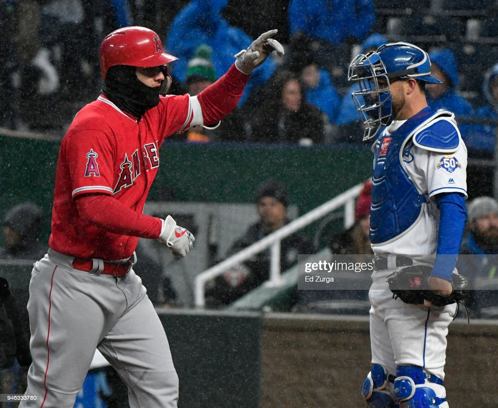 Mike Trout #27 of the Los Angeles Angels of Anaheim celebrates his two-run home run as he crosses home past Drew Butera #9 of the Kansas City Royals in the fifth inning at Kauffman Stadium on April 14, 2018 in Kansas City, Missouri.