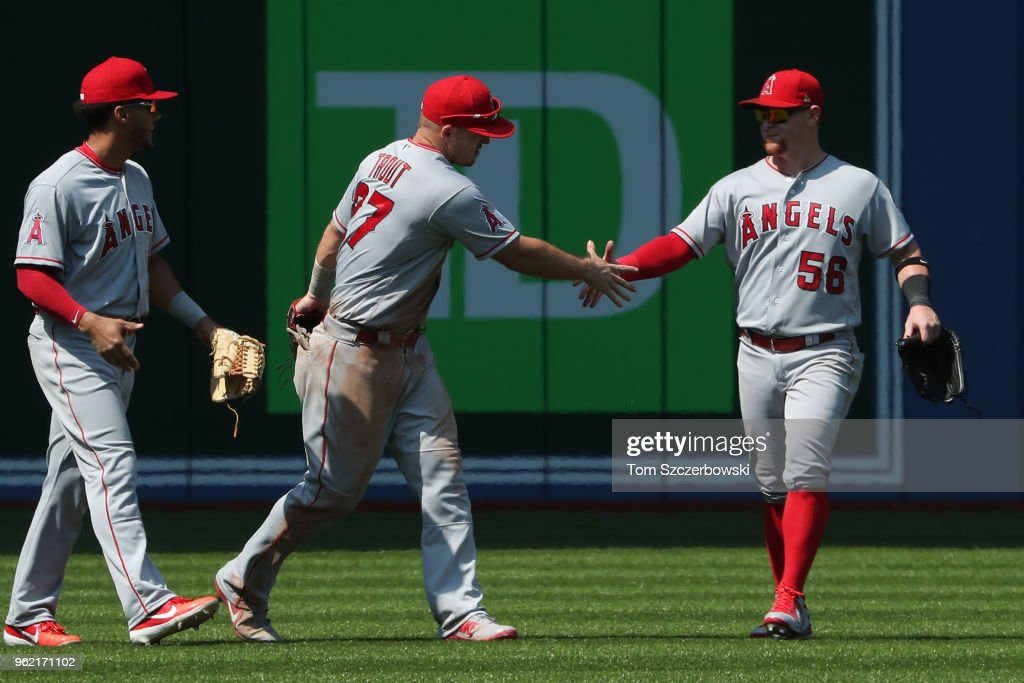Mike Trout #27 of the Los Angeles Angels of Anaheim celebrates their victory with Kole Calhoun #56 during MLB game action against the Toronto Blue Jays at Rogers Centre on May 24, 2018 in Toronto, Canada.