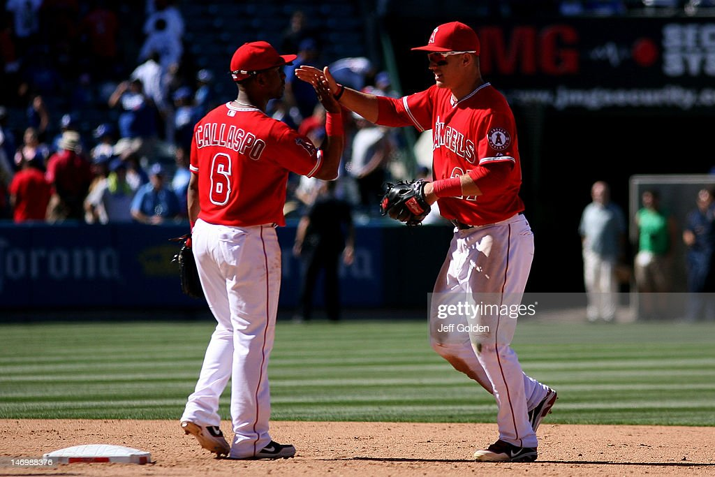 Mike Trout #27 of the Los Angeles Angels of Anaheim celebrates with teammate Alberto Callaspo #6 after the victory against the Los Angeles Dodgers in the interleague game at Angel Stadium of Anaheim on June 24, 2012 in Anaheim, California. The Angels won 5-3.