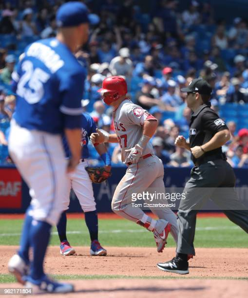 Mike Trout of the Los Angeles Angels of Anaheim circles the bases after hitting a solo home run in the fifth inning during MLB game action as Marco...