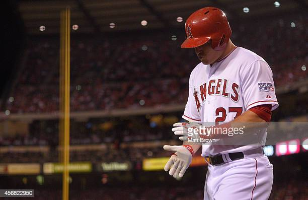 Mike Trout of the Los Angeles Angels of Anaheim claps his hands while walking off the field during the game against the Kansas City Royals during...