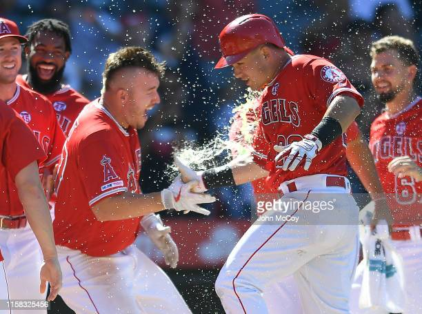 Mike Trout of the Los Angeles Angels of Anaheim congratulates Matt Thaiss for his ninth inning walk-off home run to defeat the Baltimore Orioles at...