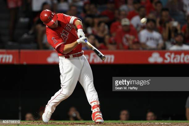 Mike Trout of the Los Angeles Angels of Anaheim connects for a tworun homerun during the third inning of a game against the Philadelphia Phillies at...