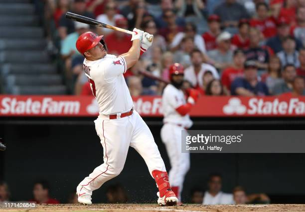 Mike Trout of the Los Angeles Angels of Anaheim connects for an RBI single during the second inning of a game against the Boston Red Sox at Angel...