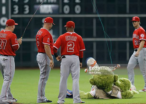 Mike Trout of the Los Angeles Angels of Anaheim has some fun with Houston Astros mascot Orbit as Albert Pujols and Erick Aybar look on at Minute Maid...