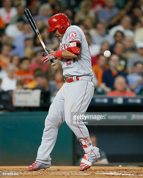 Mike Trout of the Los Angeles Angels of Anaheim has the ball hit off the bat handle for an out in the third inning against the Houston Astros at...
